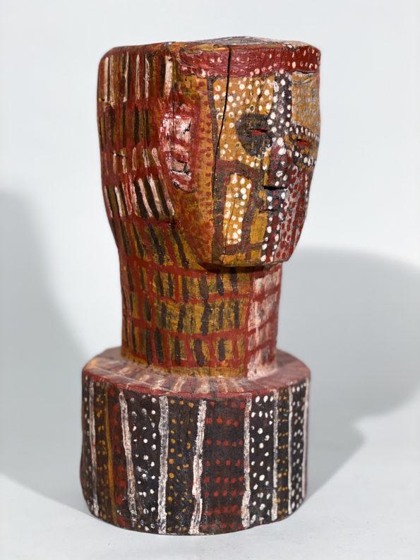 Painted Bustattributed to Aboriginal Tiwi artist Kitty Kantilla (Kutuwalumi Purawarrumpatu)